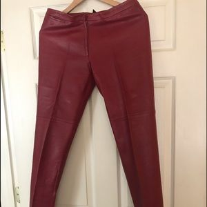 BCBG burgundy/red leather pants.